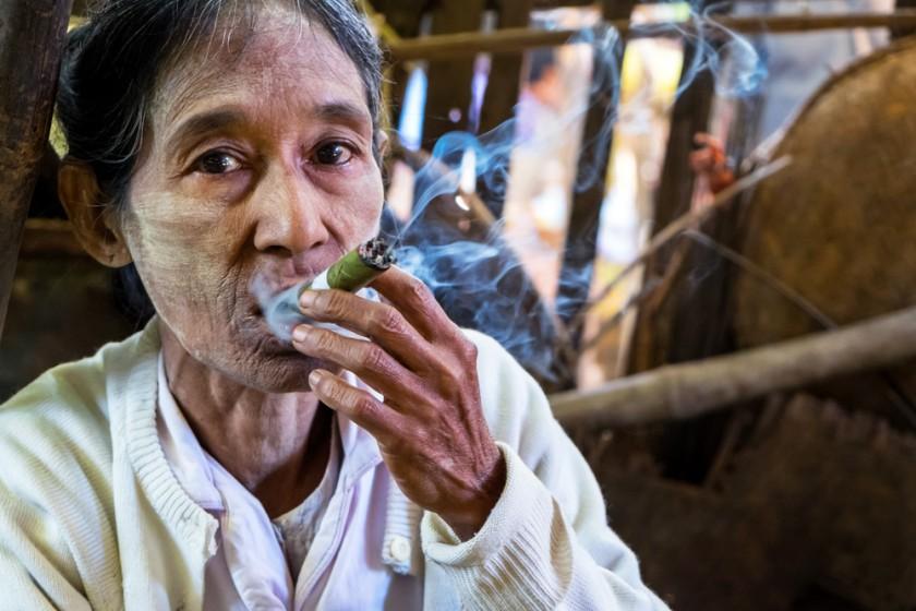 Old Burmese woman smoking a cigar