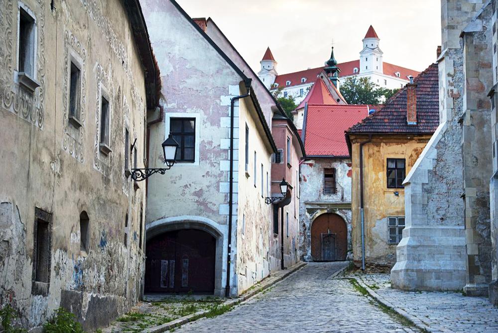 Street of Bratislava old town. Bratislava castle on top
